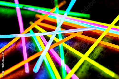 Multicolor fluorescent chem light neon black background Tableau sur Toile