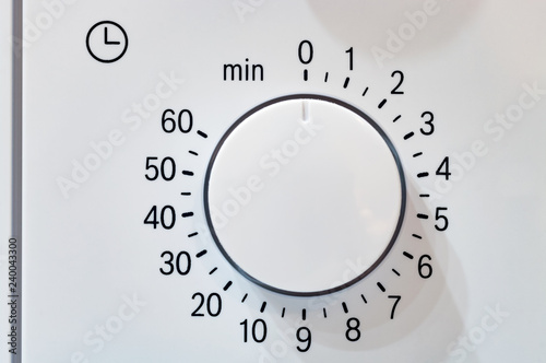 Microwave oven circular timer for one hour, analogue white.
