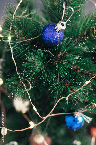 Christmas decorations on the tree with blurred background Wallpaper Mural