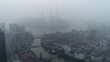 High angle drone flight over quiet urban landscape of Shanghai in the early morning