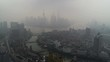 Panoramic drone flight over Shanghai skyline at cloudy moody morning