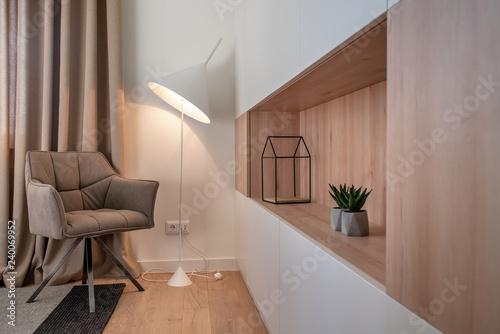 Stylish modern interior with white walls and luminous lamp Canvas Print