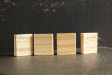 Blank Wood Scrabble Pieces Isolated On Grunge Black Background.