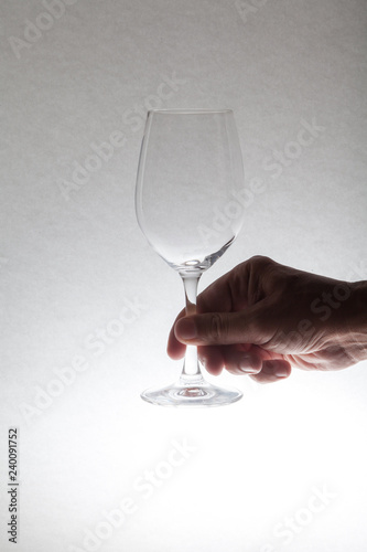 Glass wine glass in hand