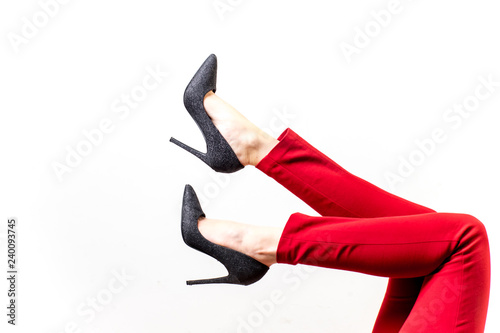 Fotografie, Obraz  Female legs in red trousers and shoes