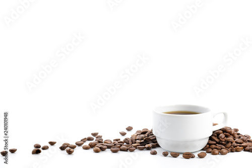 Coffee cup and coffee beans was poured on a white background.