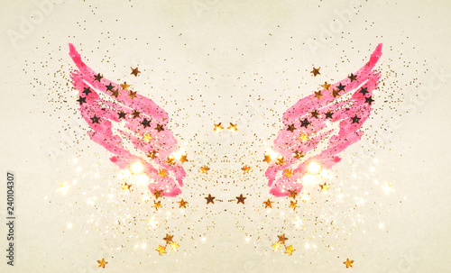 Poster de jardin Papillons dans Grunge Golden glitter and glittering stars on abstract pink watercolor wings in vintage nostalgic colors.