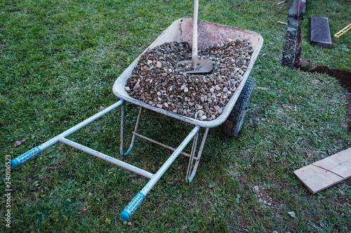 Fotografia Garden wheelbarrow with gravel
