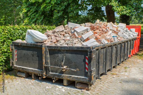 Fototapeta Debris container with stones and toilet