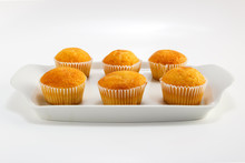 Cupcakes On A White Plate On A Light Background
