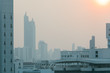 Air pollution effect made low visibility cityscape with haze and fog from dust in the air during sunset in Bangkok, Thailand.