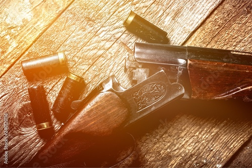 Photo Vintage rifle and sleeves on wooden table