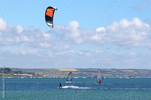 Kitesurfer and windsurfers in Portand Harbour