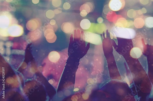Audience with hands raised at a music festival and lights - 240129397