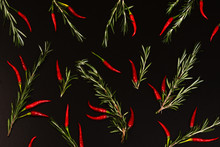Red Hot Pepper And Basil On A Black Background