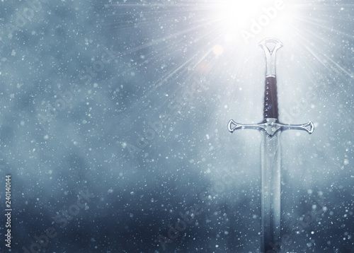 mysterious and magical photo of silver sword over gothic snowy black background Wallpaper Mural