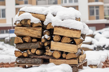 Wood Pile Stack Of Firewood Under The Snow. Stack Of Cut Wood Under The Snow.