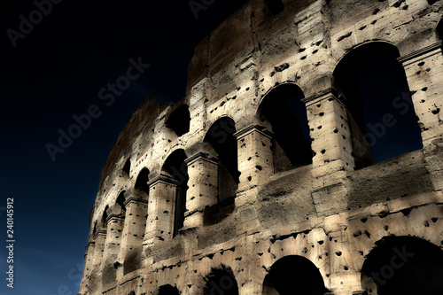 Fotografia, Obraz  A section of the facade of the Colosseum (Flavian Amphitheatre) in Rome during the blue hour