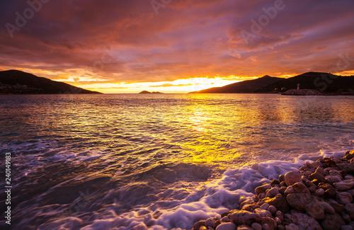 Obraz premium Zachód słońca nad morzem