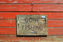 Gone Fishing Sign Written On A...