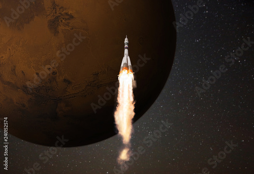 Space rocket flies to the planet Mars against a starry background. Space travel concept