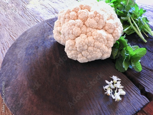 Fresh organic white vegetable cabbage raw vegetable on rustic table