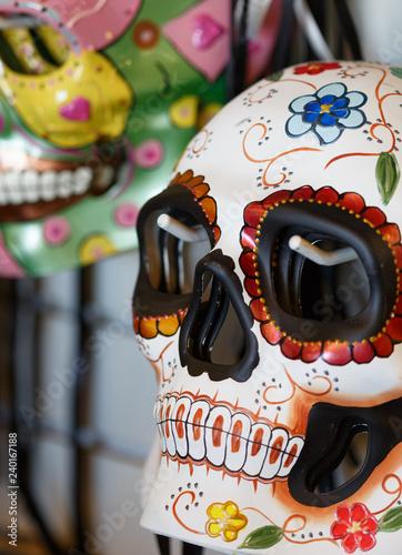 Closeup of Dia de los Muertos sugar skull masks hanging in store Canvas Print