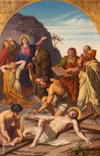 PRAGUE, CZECH REPUBLIC - OCTOBER 15, 2018: The painting Jesus is nailed to the cross (cross way station) in church Bazilika svatého Petra a Pavla na Vyšehrade by František Čermák (1822 - 1884).