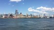 HOBOKEN - JULY 23, 2016: View of West side Manhattan skyline New York City from New Jersey over Hudson River. Empire State Building, Hotel Pennsylvania, Chelsea Piers, Hudson Rail Yards in the shot.