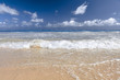 Soft Wave Of Blue Ocean On Sandy Beach. Background. Splash of waves on the sandy beach. foam, surf, waves