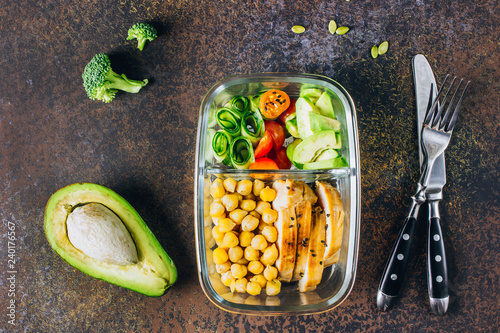 Poster Assortiment Healthy meal prep containers chicken and fresh vegetables.