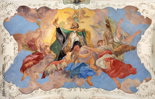 PRAGUE, CZECH REPUBLIC - OCTOBER 12, 2018: The baroque ceilinig fresco of St. Augustine among the angels in church kostel Svatého Tomáše by Václav Vavřinec Reiner (1689 - 1743).