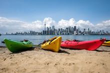 Colorful Kayaks On A Beach Wit...