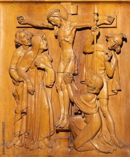 PRAGUE, CZECH REPUBLIC - OCTOBER 15, 2018: The wooden carved relief of Cricifixion in church Bazilika svatého Petra a Pavla na Vyšehrade from 20. cent.