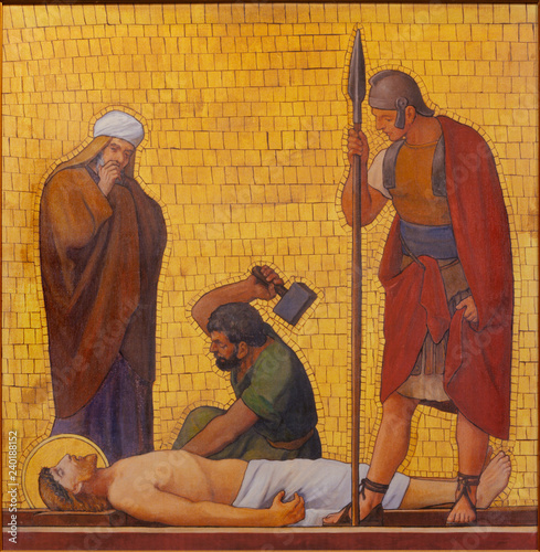 PRAGUE, CZECH REPUBLIC - OCTOBER 17, 2018: The painting Jesus is nailed to the cross (cross way station) in the church kostel Svatého Cyrila Metodeje by S. G. Rudl (1935).