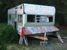Abandoned Camping Trailer Left Behind In The Deep Woods On Vancouver Island In British Columbia. The Interior Is Messy, Windows Are Missing And Nobody Is Living Inside Or Using It For Any Purpose.