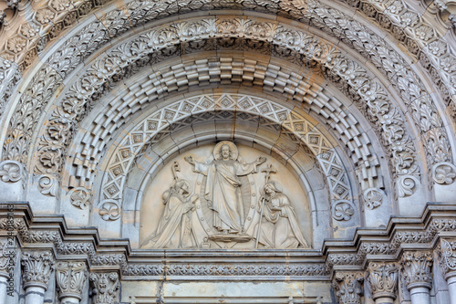 PRAGUE, CZECH REPUBLIC - OCTOBER 17, 2018: The relief of Jesus and st. Cyril and Metodius on the portal of the church kostel Svatého Cyrila Metodeje by Václav Levý (1867 - 1869).