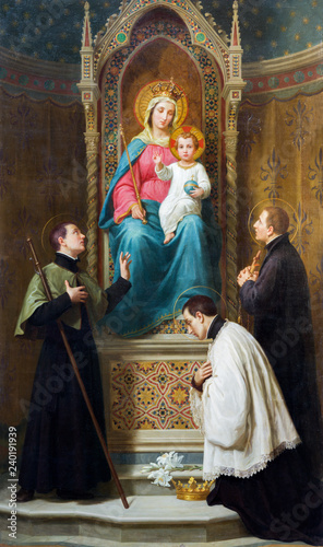 MODENA, ITALY - APRIL 14, 2018: The painting of Madonna with the child among the jesuit saints in church Chiesa di San Bartolomeo from 19. cent.