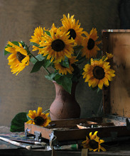 Sunflowers In A Vase On Wooden Background