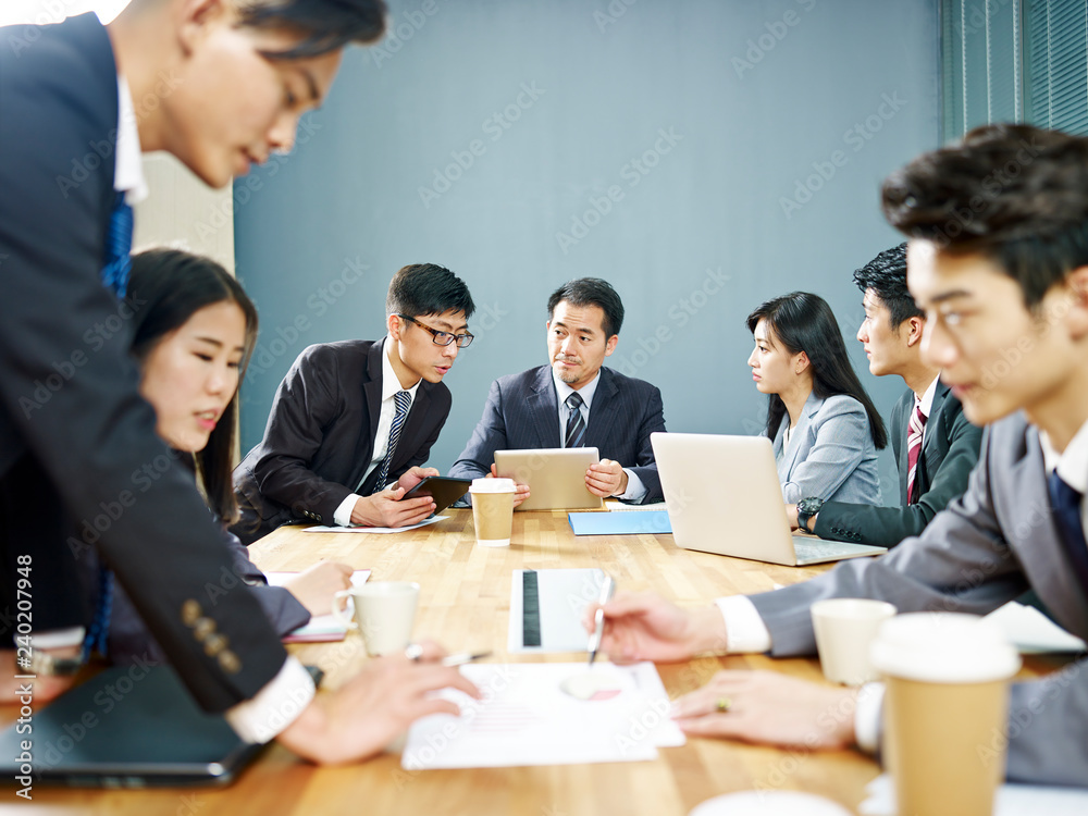 Fototapeta asian corporate people discussing business in meeting