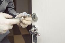 Locksmith In Rag Gloves Changes The Door Locks.
