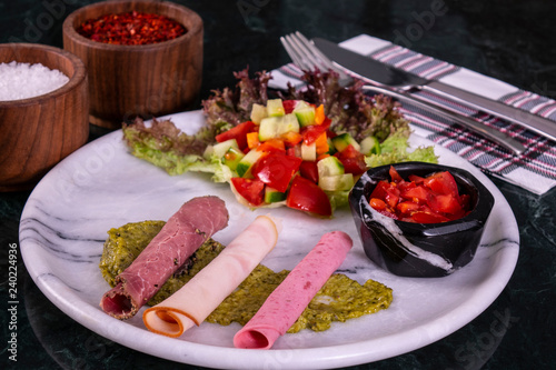 Autocollant pour porte Pique-nique Meat plate with thinly sliced salami and jamon with salad on the marble background