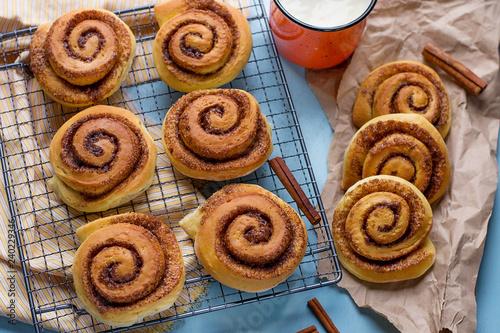 Leinwand Poster Sweet cinnamon roll bun with cream cheese glaze