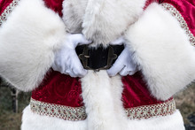 Santa Claus Holding The Belt Buckle With Both Hands