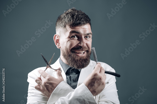 Bearded man with barber tools. Razor and scissors. Icon for barbershop. Handsome guy shaves beard. Barbershop concept.