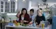 Medium shot of group of people preparing food in the kitchen
