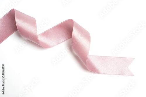 Fototapeta pink ribbon in roll on white