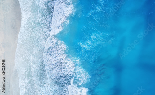 Cadres-photo bureau Mer coucher du soleil Beach and waves from top view. Turquoise water background from top view. Summer seascape from air. Top view from drone. Travel concept and idea
