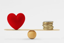 Heart And Money On Balance Sca...