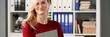 Leinwanddruck Bild - Happy smiling blond businesswoman holdig